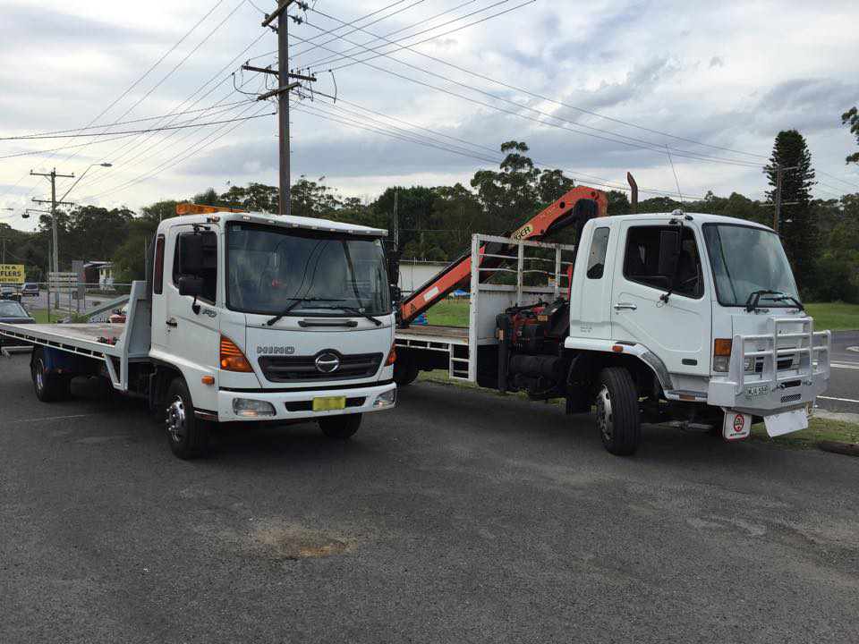 Central Coast tow trucks pick up scrap cars.